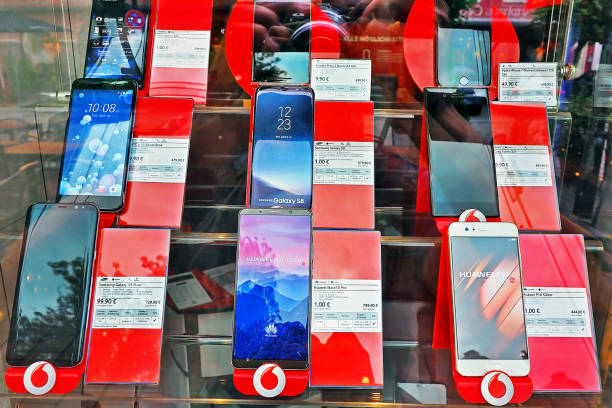 many Smartphone device prices at Vodafone shop displaying on the glass wall  in Munich City Germany Munich Germany - 14 JUNE 2018: many Smartphone device prices at Vodafone shop displaying on the glass wall  in Munich City Germany huawei stock pictures, royalty-free photos & images
