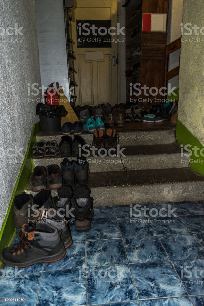 Many sneakers and mountain shoes in the corridor of the Kozya Stena...