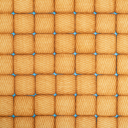 Many square shortbread cookies are stacked in rows. Can be used as a background.