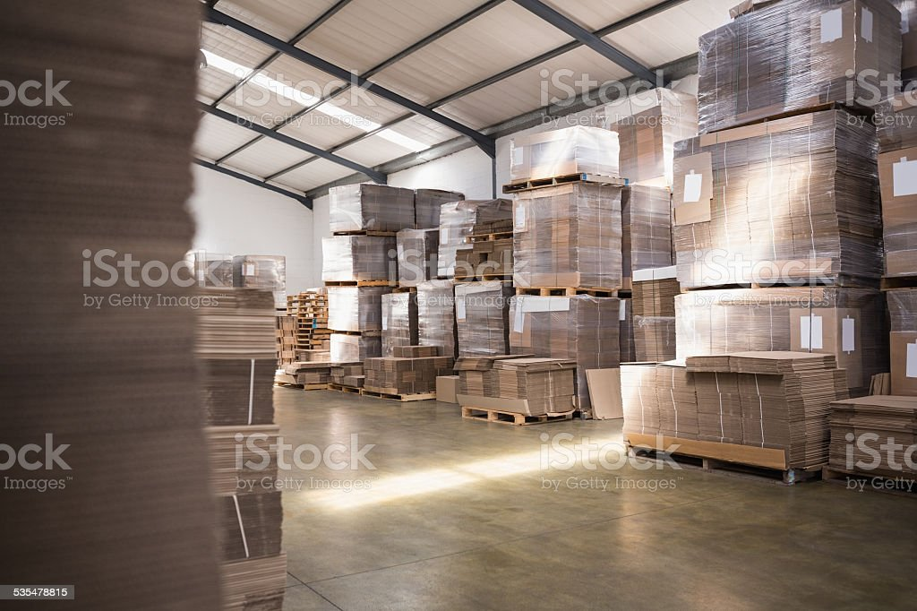 Many stack of cardboard boxes stock photo