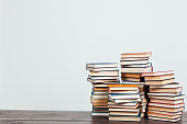 many stacks of educational books to teach at home before exams on a white background