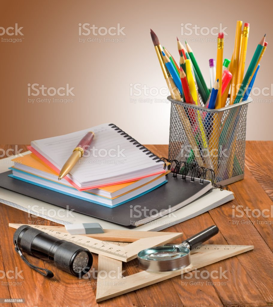 many stationer on wooden table close-up stock photo