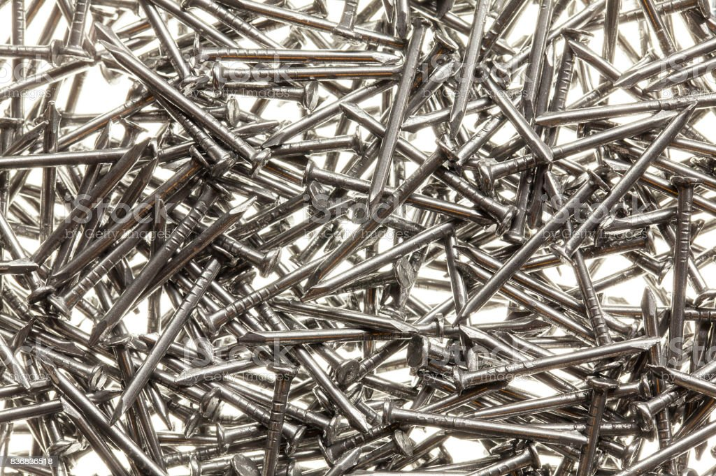 Many steel nails on white background stock photo