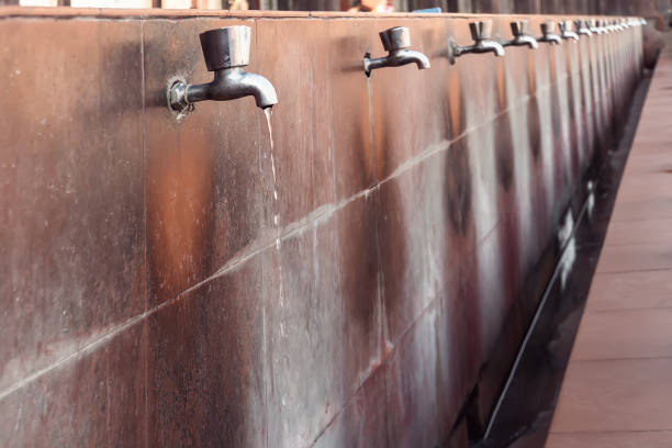many steel taps with drinking water flowing many steel taps with drinking water flowing in college bathroom water wastage stock pictures, royalty-free photos & images