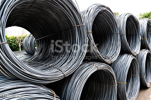 Many steel wire rolls on construction site.