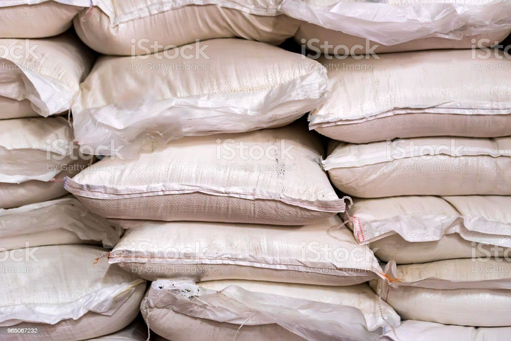 Many sugar bags stacked at modern winery zbiór zdjęć royalty-free