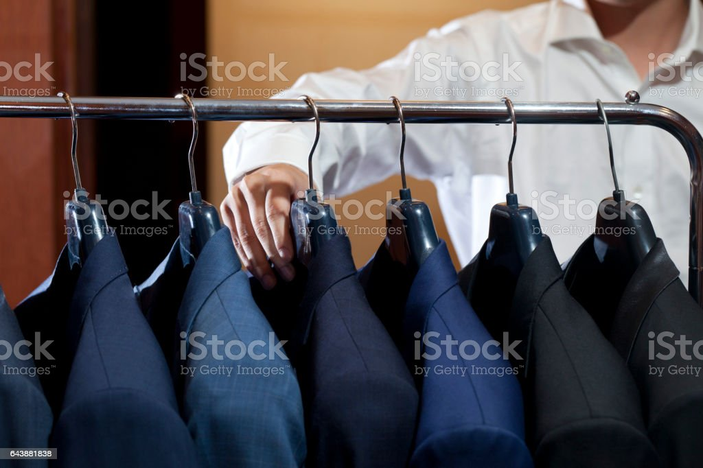 many suits on rack stock photo