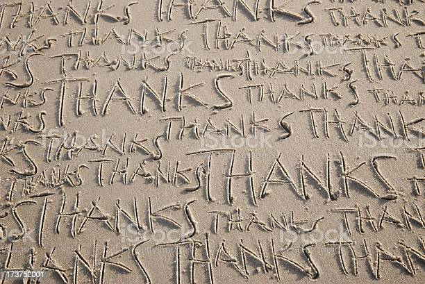 Many Thanks Message Handwritten On Sand Beach Stock Photo - Download Image Now