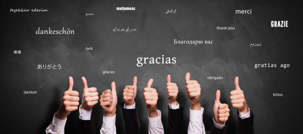 many thumbs up and chalkboard with message THANK YOU in different languages stock photo