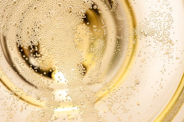 Many tiny bubbles in a champagne glass stock photo
