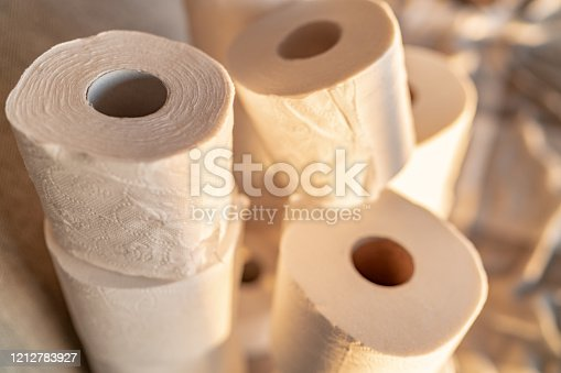 Many toilet paper rolls at home of hoarder hoarding amidst panic buying for corona virus outbreak shortage.