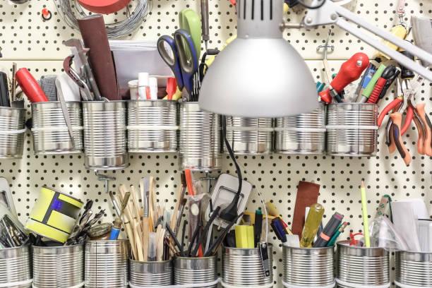Many tools hang on wall tool panel stock photo