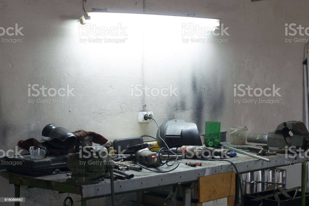 Many tools lying on a table in garage stock photo