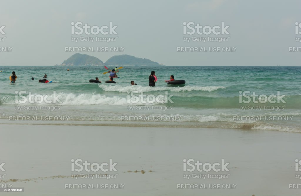 Many tourists enjoy swimming stock photo
