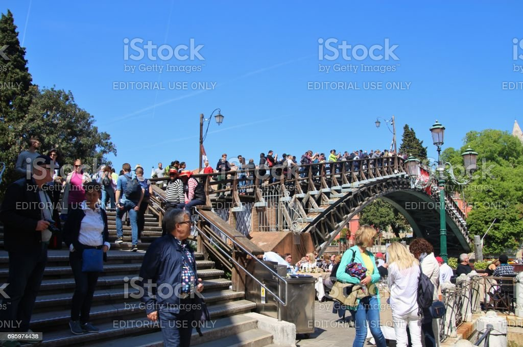 Many tourists on the bridge ponte dell Accademia, Venice, Italy. stock photo