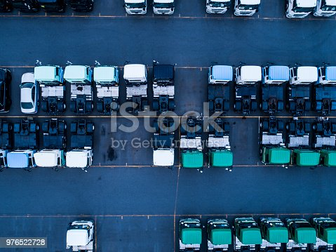 Many trucks are beautifully parked in the parking lot.