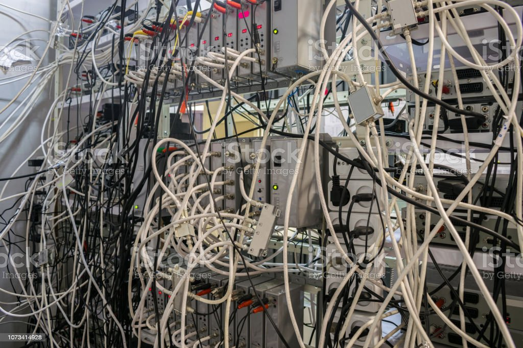 Muchos Cables De Tv Al Azar Se Entremezclan Entre Sí En Los ... on cable tv construction, cable tv jumper wire, ribbon cable, cable tv service, cable tv repair, category 5 cable, cable tv installation, cable tv equipment, cable tv grounding, cable tv splitter, communications satellite, networking cables, rf connector, bnc connector, cable tv conduit, cable tv software, shielded cable, radio frequency, cable tv hardware, component video, cable tv mounts, cable tv switch, cable tv transmitter, cable tv framing, optical fiber cable, cable tv outlets, category 6 cable, cable tv connectors, cable tv antenna, cable tv plugs, f connector, ethernet crossover cable, cable tv computer,