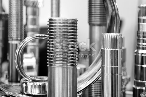istock Many types of metal details industrial design background. Close up view on brand new drill bit roller cutter for drilling machines and equipment for oil and gas industry,  industrial engineering concept. 970380132