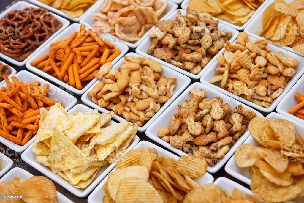 Many types of savoury snack in white dishes stock photo