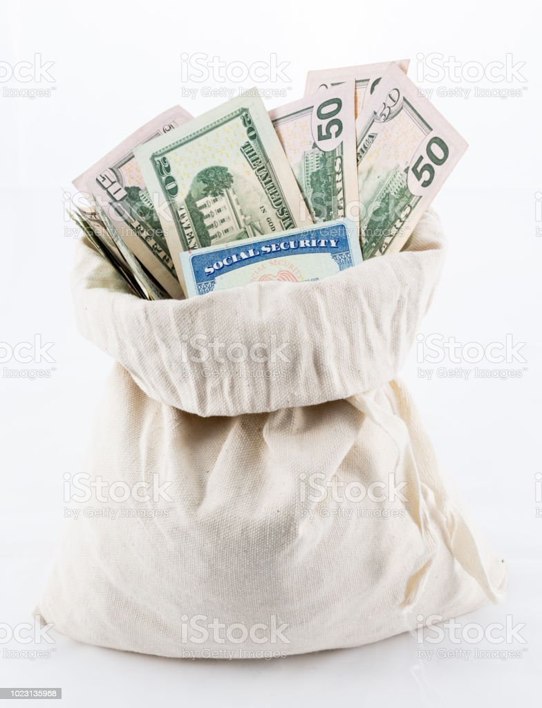 Many US dollar bills or notes in money bag with social security card stock photo