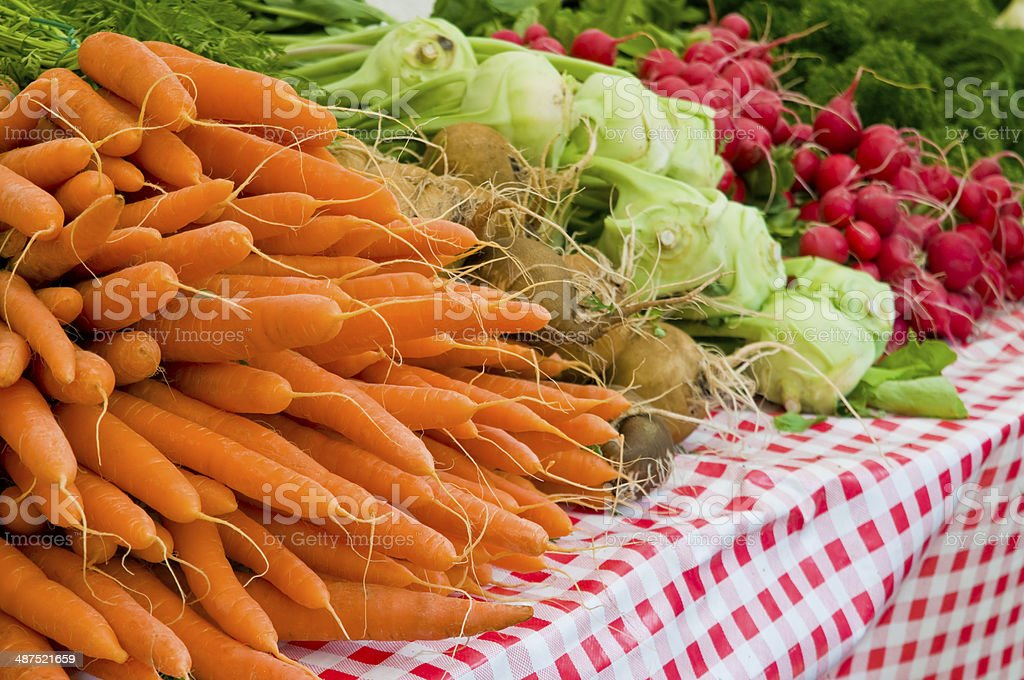 Many varios vegetabel on a market: carotts, kohlrabi, radishes royalty-free stock photo