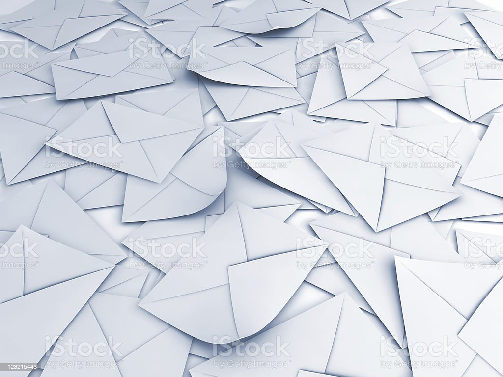 Many white envelopes are scattered in a pile  stock photo