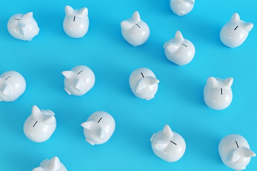 Many White Piggy Bank on blue background. top view. minimal concept ideas.