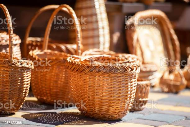 Photo of Many wicker baskets are sold. Products made of birch bark.