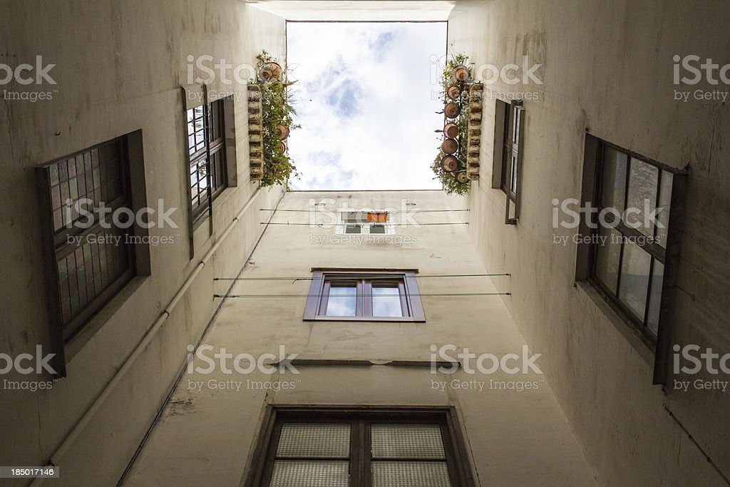 Many windows in a small internal courtyard stock photo