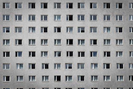 many windows on building facade - apartment block