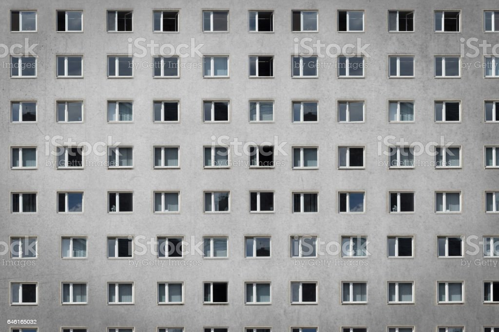 many windows on building facade - apartment block stock photo