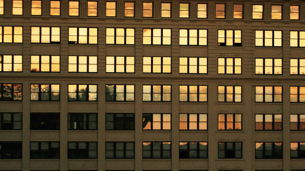Many windows with twilight color reflection at the building in New York city, USA. Abstract colorful urban business building stock photo