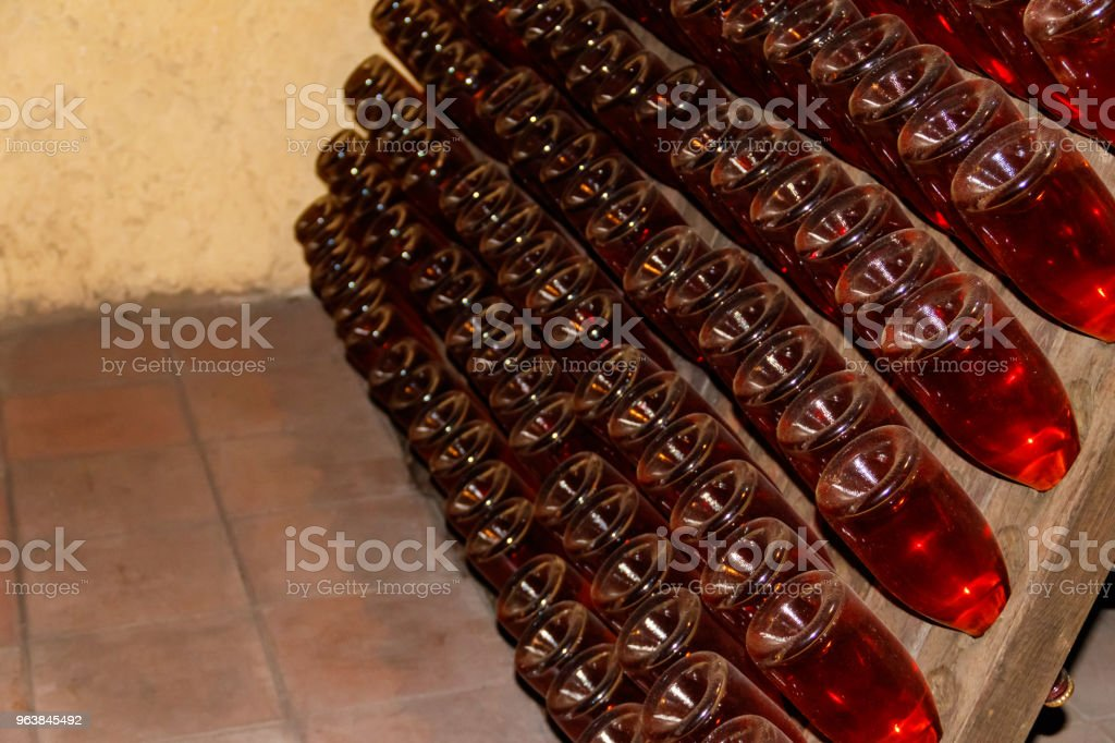 Many wine bottles in wine cellar of winery - Royalty-free Abundance Stock Photo