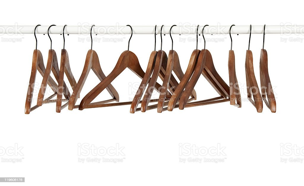 Many wooden hangers on a rod Many wooden hangers on a rod, isolated on white background. Brown Stock Photo