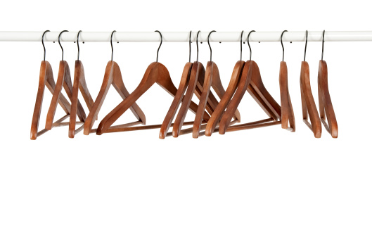 Many Wooden Hangers On A Rod Stock Photo - Download Image Now