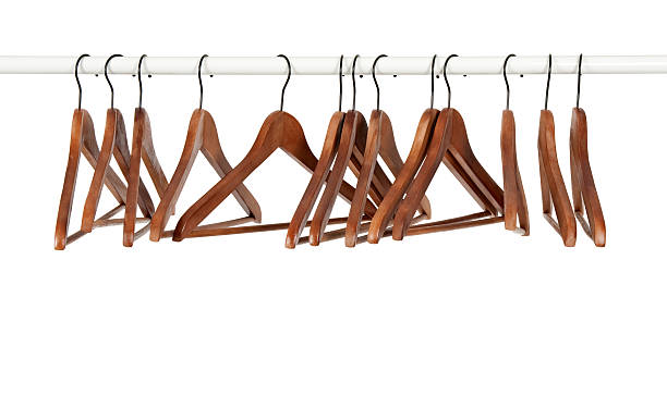 Many wooden hangers on a rod stock photo