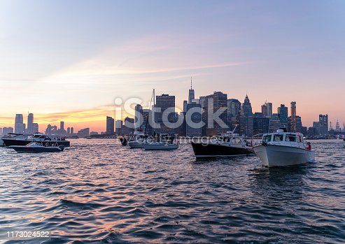 Multiple yachts in front of Manhattan Downtown.
