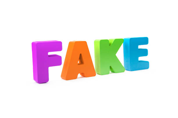 many-colored isolated wooden word fake made with 3d text effect. concept of false information, distortion of fact. misinformation sign on white background. mass media fake news. falsehood about event. - delude stock pictures, royalty-free photos & images