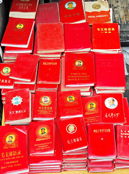 Mao red books Shanghai, China-May 4, 2007: Dongtai Lu Antique Market Mao red books on sales. During Mao rule almost every person in china had a red book, mao tse tung stock pictures, royalty-free photos & images