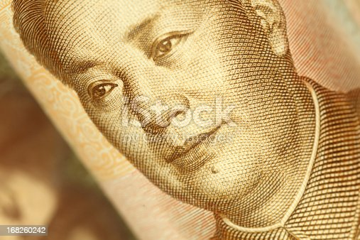 Macro of the portrait of Mao Tse-tung on Chinese yuan banknote. High resolution photo taken with Canon 5D Mark II and Sigma lens.
