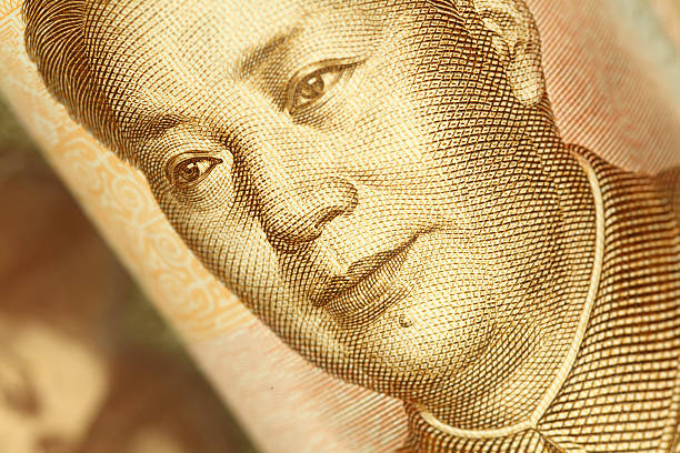 Mao Tse-tung Portrait on Chinese Yuan Banknote |Finance and Business Macro of the portrait of Mao Tse-tung on Chinese yuan banknote. High resolution photo taken with Canon 5D Mark II and Sigma lens. mao tse tung stock pictures, royalty-free photos & images