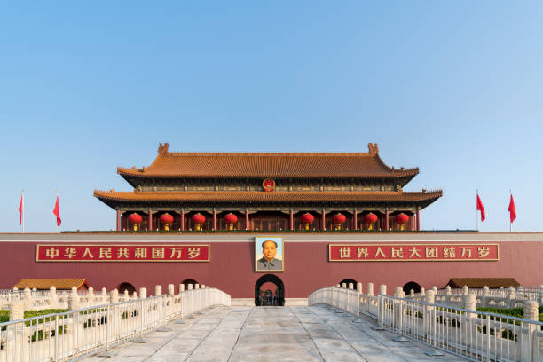 Mao Zedong's portrait hangs over Beijing Tiananmen Gate at the Forbidden City in Beijing, China. Mao Zedong's portrait hangs over Beijing Tiananmen Gate at the Forbidden City in Beijing, China. mao tse tung stock pictures, royalty-free photos & images