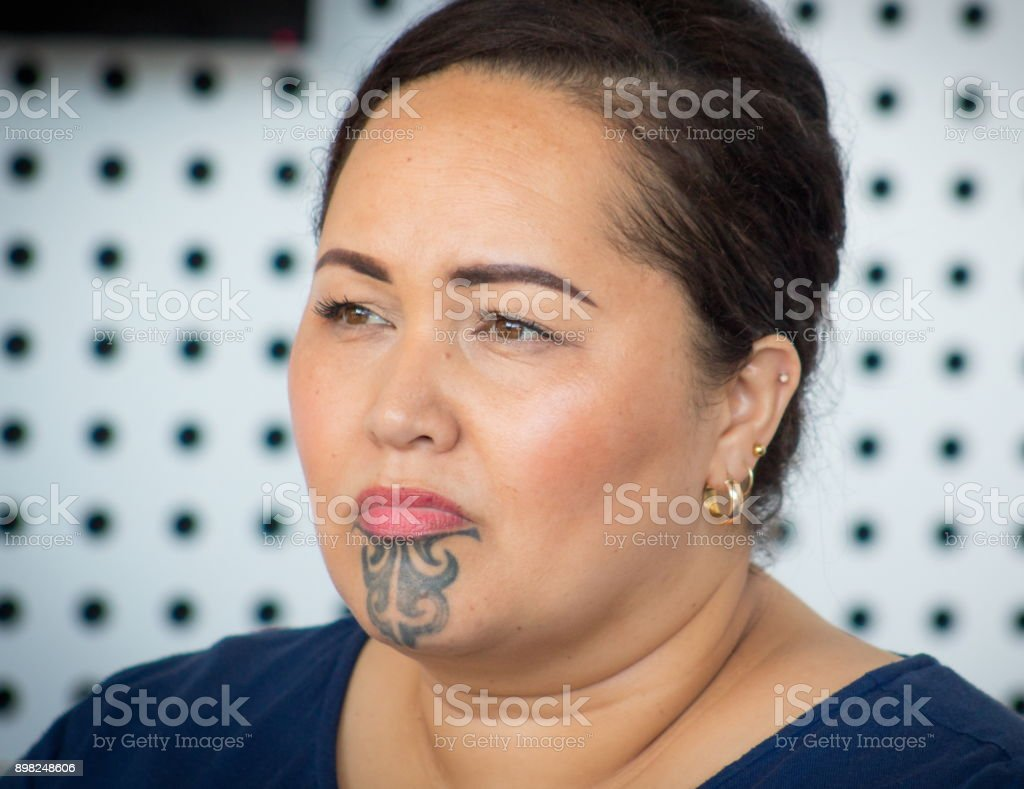 A Maori business woman in the workplace in New Zealand. stock photo