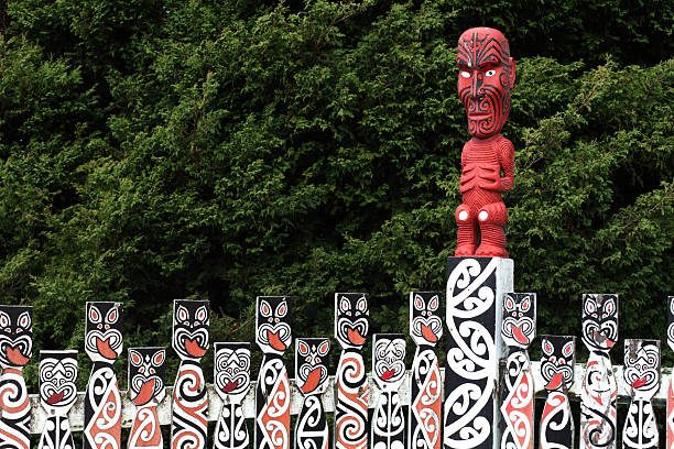 maori carved poles in new zealand  - maori stock photos and pictures