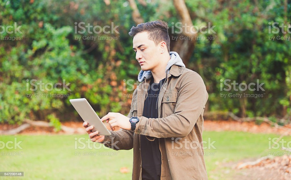 Maori Man using Tablet. royalty-free stock photo