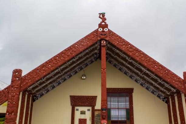 Maori Meeting house (wharenui) in Maori village Rotorua, New Zealand- October 29, 2017: Maori Meeting house (wharenui) in Maori village whakarewarewa stock pictures, royalty-free photos & images