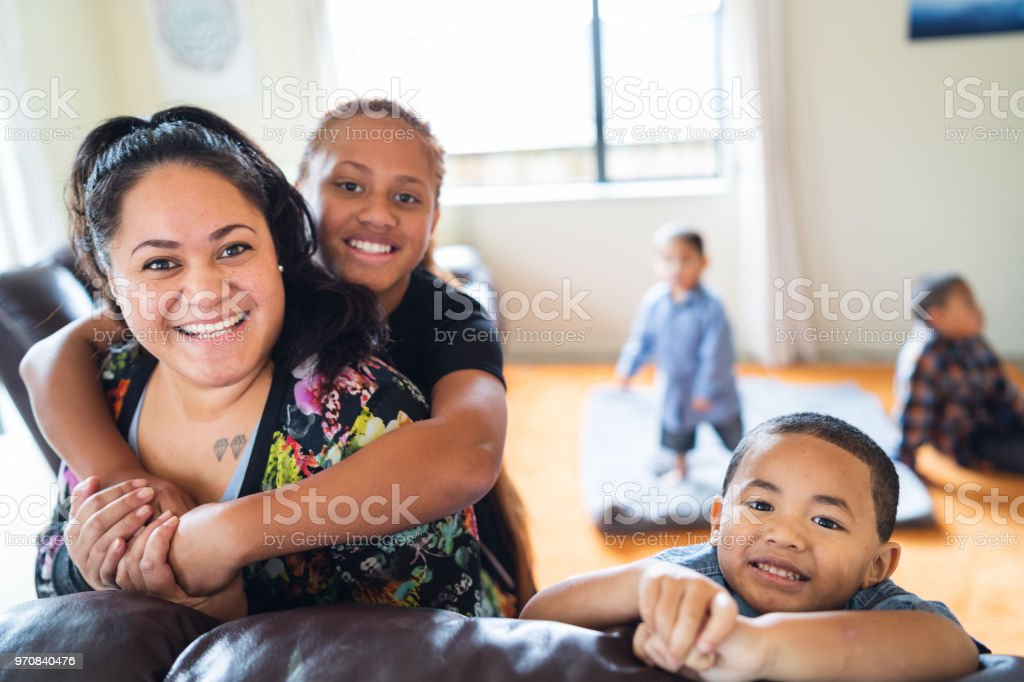 Maori mother with kids at home. stock photo