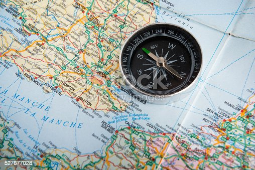 97623256istockphoto map and a compass 527677028