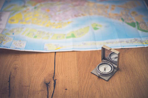 97623256 istock photo Map and compas 698195778