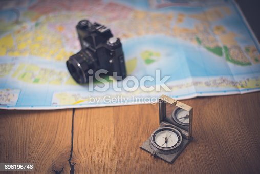97623256istockphoto Map and compas 698196746